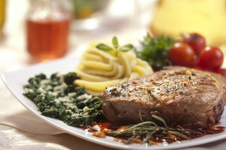 spaniard: Delicious beef steak with spaniard and potatoes Stock Photo