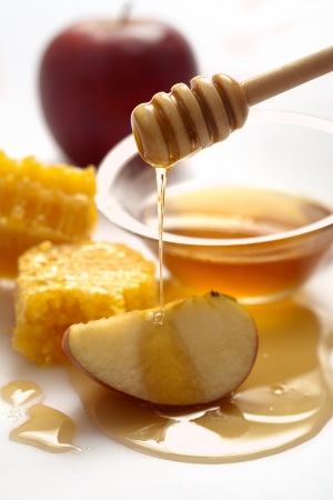 rosh: Honey dripping on a apple Stock Photo