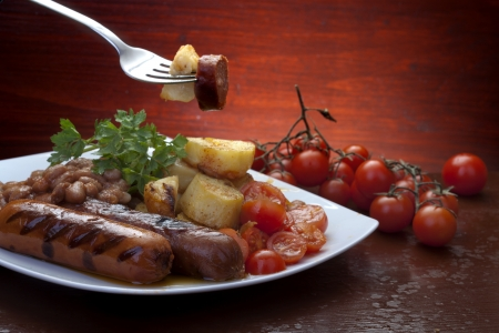Baked beans, sausage and potato photo