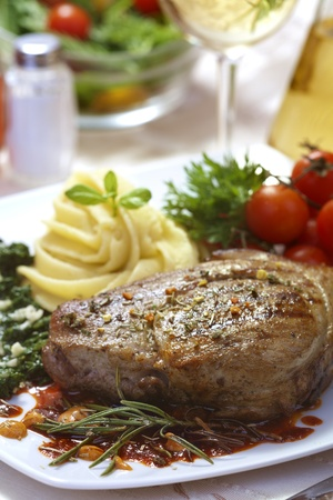 Delicious beef steak with spaniard and potatoes photo