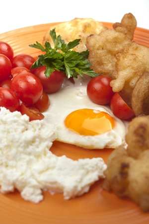 Breakfast with eggs and cheese and tomatoes photo