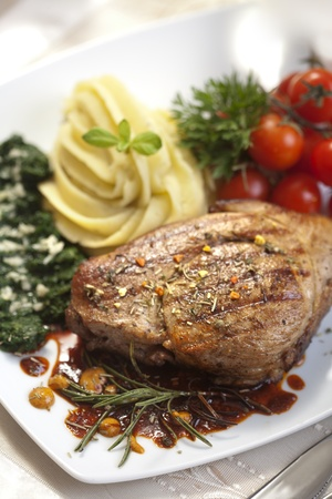 Delicious beef steak with spaniard and potatoes Stock Photo