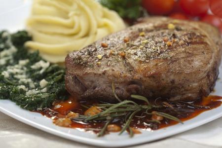spaniard: Delicious beef steak with spaniard and potatoes Stock Photo