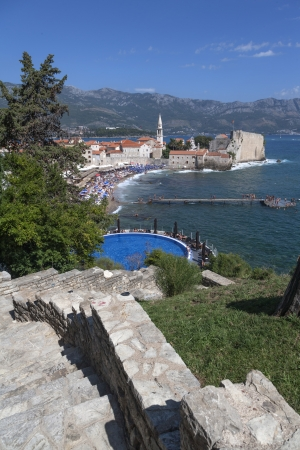 inground: Swimming pool overlooking the beach in Budva, Montenegro Stock Photo