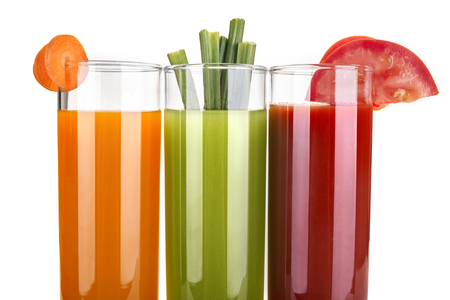 juicing: juice of carrots, celery and tomatoes Stock Photo