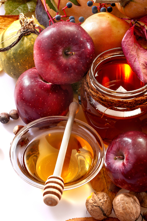 honey, apples and autumn fruits photo