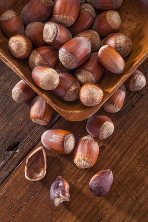 hazelnuts on the wooden table photo
