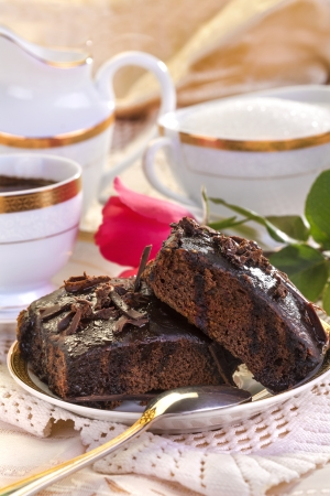 delicious traditional homemade cake with rose and coffe photo