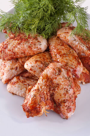 piri:  fresh chicken wings with spices and the sauce Stock Photo
