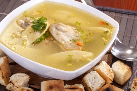 homemade chicken soup with pasta and vegetables photo