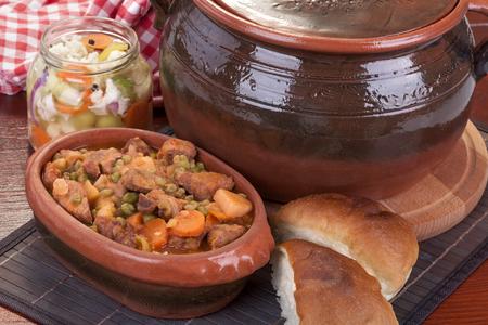 Traditional goulash or pork stew, in red crock pot 版權商用圖片