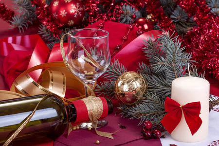 festively: festively decorated glass and a bottle of wine to celebrate the New Year or Christmas