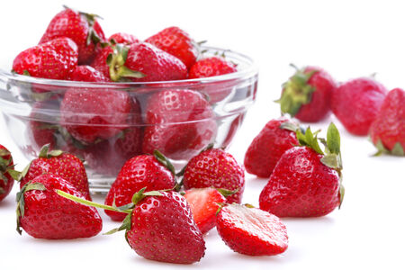 healthily: healthily raised organic strawberries in a glass bowl on white Stock Photo