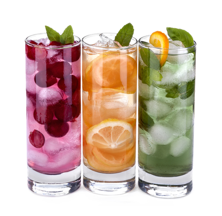 iced drink with orange, cherry and mint isolated on white background