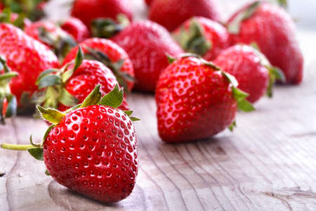 healthily: healthily raised organic strawberries on a wooden table