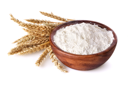 flour with wheat in a wooden bowl on a white background Standard-Bild