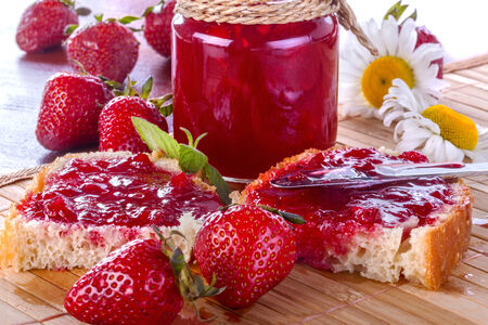 Fresh and healthy homemade strawberry jam on the table photo