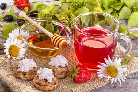 healthy fruit tea with cakes and honey photo