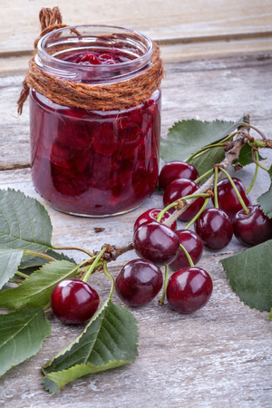 Homemade jam from organically grown and healthy cherries photo