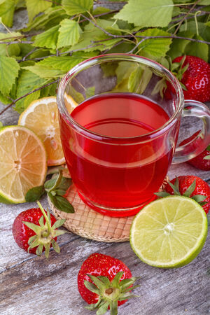 fresh and healthy homemade strawberry tea with lemon photo