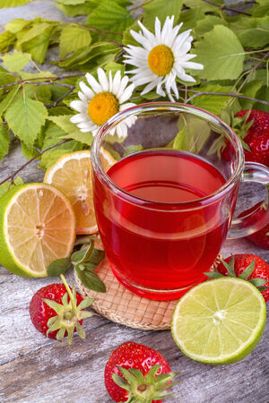 fresh and healthy homemade strawberry tea with lemon photo