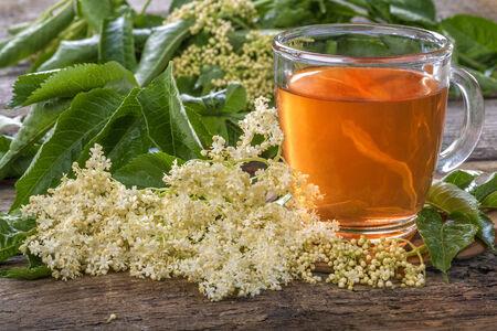Domestic healthy elder  tea on a rustic wooden table photo