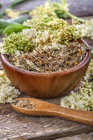 linden tea in a wooden bowl and scoop photo