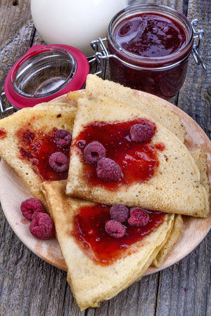 homemade and delicious pancakes with raspberry jam