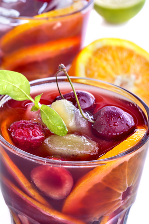 Sangria with citrus and other fruit on a white background photo