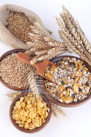 musli: Muesli, cornflakes and ripe wheat as an illustration of healthy food