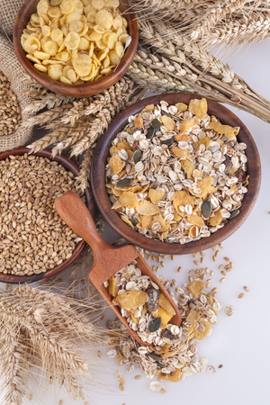 Muesli, cornflakes and ripe wheat as an illustration of healthy food