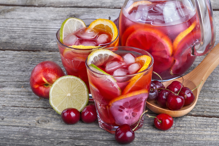 Ice refreshing summer drink with lots of different fruits