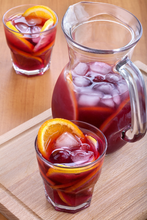 ice refreshing summer drink with lots of different fruits Standard-Bild