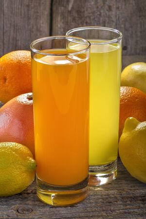 A refreshing orange juice and lemonade with orange, lemon and grapefruit photo