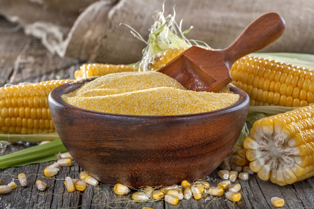 corn grits polenta in a wooden bowl on old wooden table 版權商用圖片