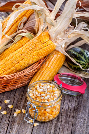 glass jar filled with sweet canned corn photo