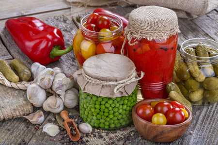 canned peas: canned peas, tomatoes, peppers and pickles in jars Stock Photo