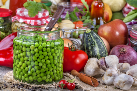 canned peas: Canned peas with different fruits and vegetables in the background