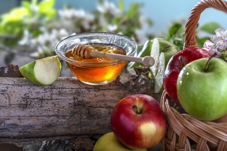Domestic apples and honey on the natural rustic background photo