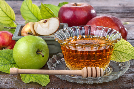honey apple: apples with a bowl with honey on the old wooden table