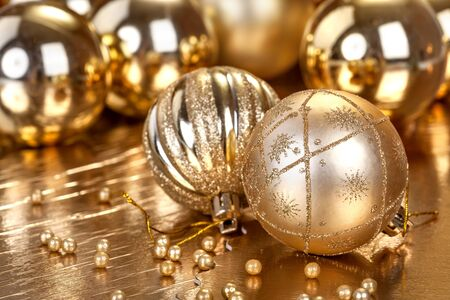 golden ball: Festive Christmas and New Year decoration with ornaments Stock Photo
