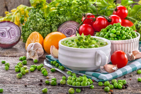 potage: Potage soup made from fresh domestic peas with spices Stock Photo