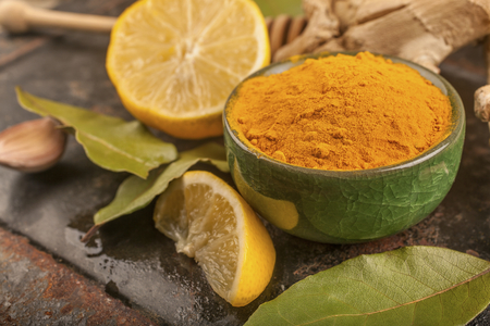 turmeric, lemon and laurel on a rustic surface, the concept of natural nutrition and medicine Reklamní fotografie