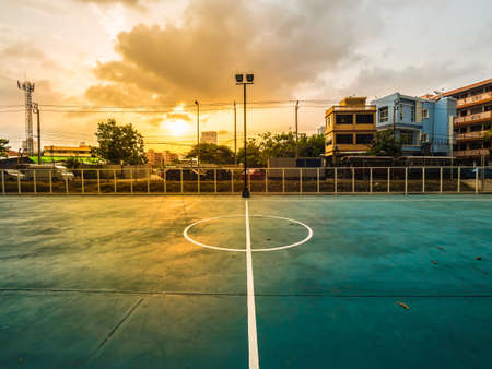 soccer field line, soccer field is under expressway, football field is under expressway, soccer field is urban with sunlight in sunset Stock Photo