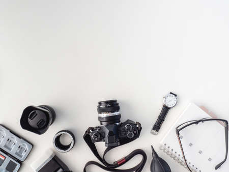 top view of work space photographer with digital camera, flash, cleaning kit, white table background. Reklamní fotografie