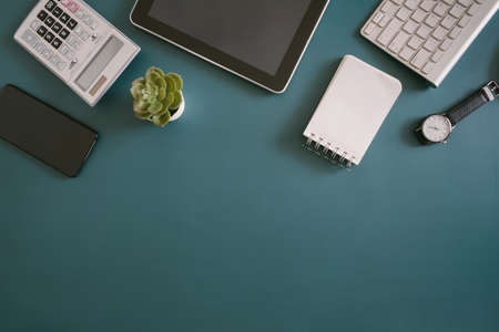 top view of office desk table with tablet and smartphone on background, graphic designer, Creative Designer concept.