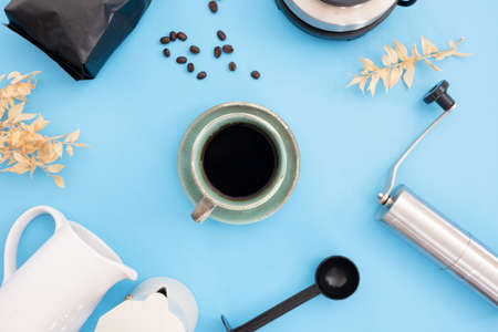 coffee cup and moka pot on table background in kitchen room, coffee shop.