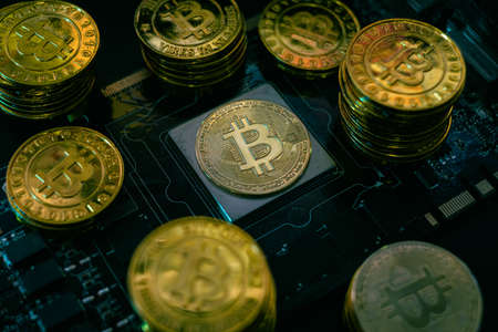 cryptocurrency concept with Golden coins with bitcoin symbol