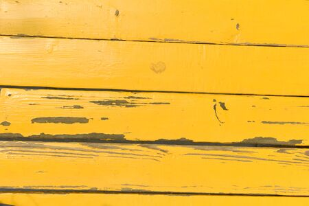painted wood: A rustic yellow painted wood background.