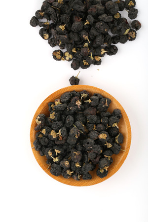 wolfberry: Traditional Chinese  black herbs dried wolfberry close up on a small plate